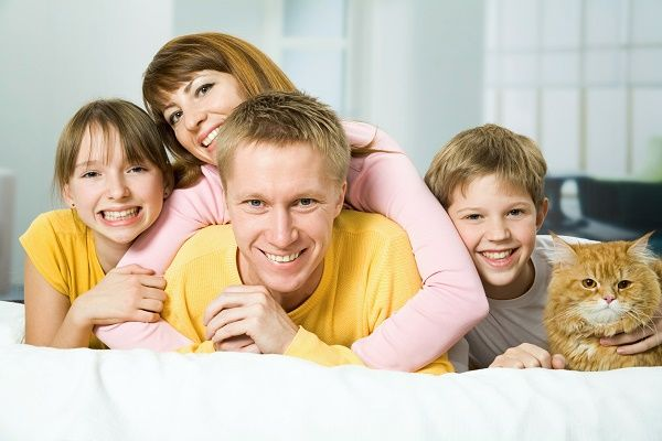 Family of four on a bed